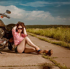 Fototapete - Biker girl and motorcycle
