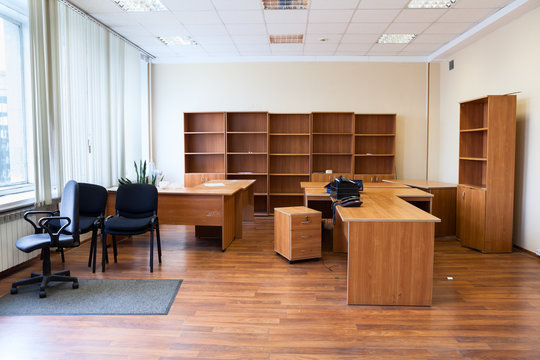 Remaining furniture as tables, chairs and cabinets in empty office after the tenant's eviction