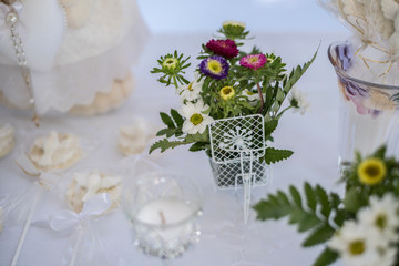 Table decorated with flowers, candy and decoration