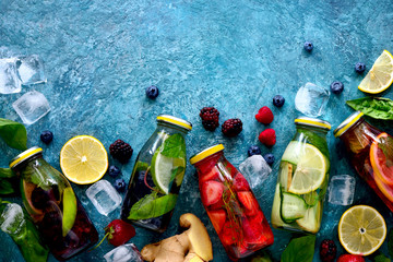 Infused water in bottles, flat lay