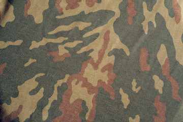 Old camouflage cloth with blur effect.