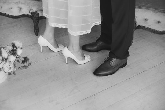 Black and white image of loving couple of man and woman during their wedding day. Horizontal color photography.