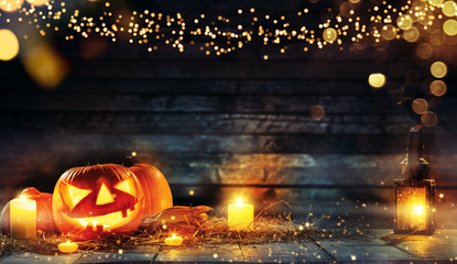 Spooky halloween pumpkins on wooden planks