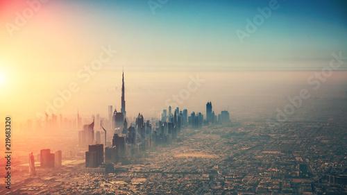 Fototapete Aerial view of Dubai city in sunset light