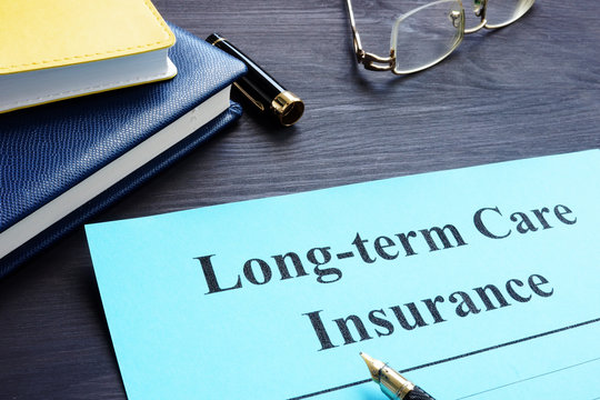 Long term Care Insurance policy on a table.