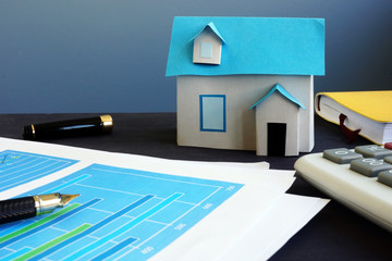 Property investment. Model of house on an office table.
