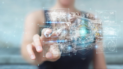 Businesswoman using wireframe holographic 3D digital projection of an engine