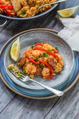 Spanish paella with prawns, chicken, chorizo and red pepper - high angle view