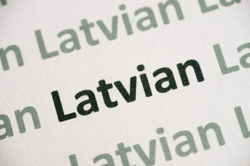 word Latvian language printed on paper macro