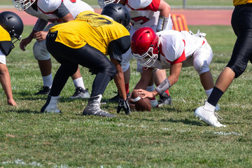Football Players setting up for the play – Hike the ball