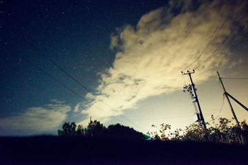 Night scene: the starry sky above the field, a long shutter speed