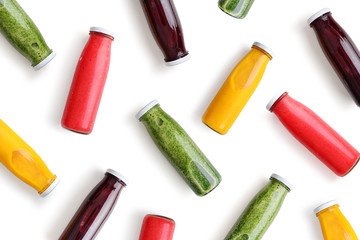 Colorful smoothies in glass bottles