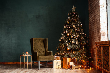 New Year background. Christmas room interior of loft. Light, gifts, candles and hot lighting indoors. An armchair with a table near a Christmas tree with gifts