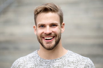 Man with perfect brilliant smile unshaven face defocused background. Guy happy emotional expression outdoors. Bearded and handsome. Man happy smiling face white brilliant teeth. Dentistry concept