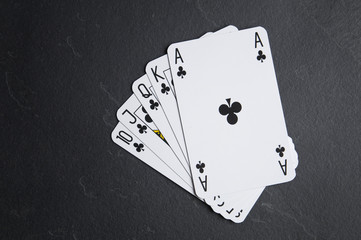 Poker cards on a dark background. Poker consisting of ace to tens of cards.