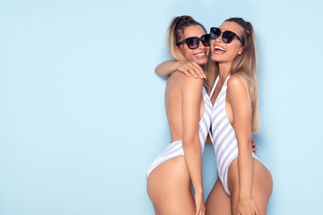 Happy sexy twins girls having fun together.