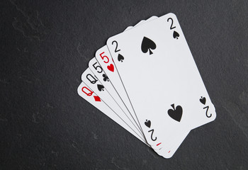 Poker cards on a dark background. A composition consisting of two different .