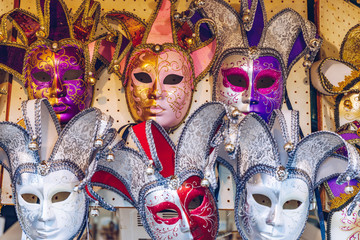 Group of Vintage venetian carnival masks. Venetian masks in store display in Venice. Annual carnival in Venice is among the most famous in Europe. Its symbol is the Venetian mask. Venice, Italy.