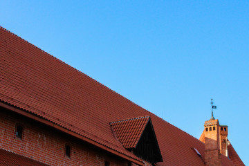 Tiled roof of ancient fortress on a background blue sky..