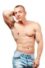 Diet  Muscular man with perfect body. Fitness man showing six pack
