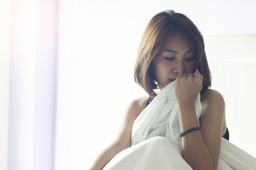 Young Asian woman wake up early morning