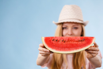 Happy woman holding watermelon