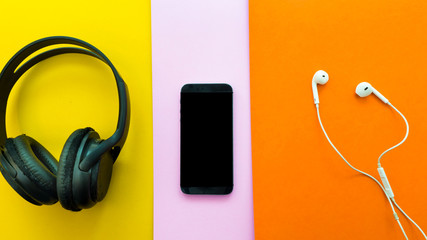 Wall Mural - Headphones,smartphone,earphone on a colorful background. Top View