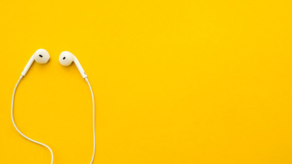 Wall Mural - Earphone on a yellow background