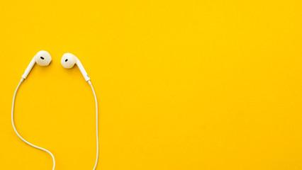 Earphone on a yellow background
