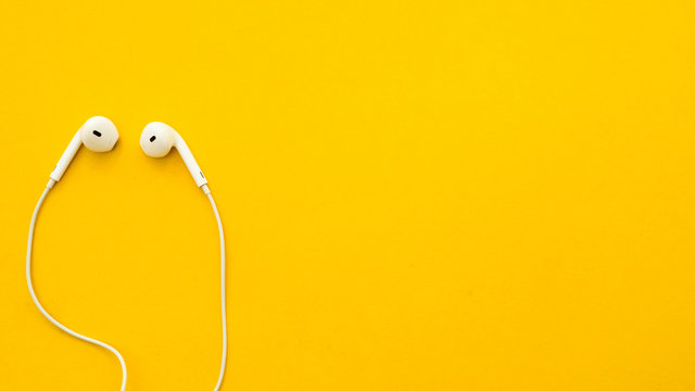 Earphone on a yellow background
