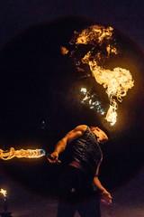 Fire show artist breathe fire in the dark