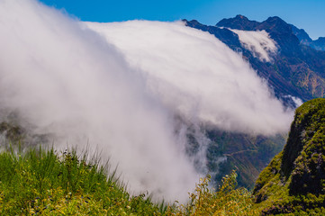 Stunning view with a cloud in the mountains. Madeira. Portugal