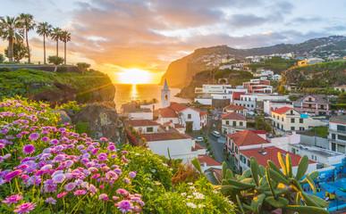 Wall Mural - Camara de Lobos village at sunset, Cabo Girao in background, Madeira island, Portugal