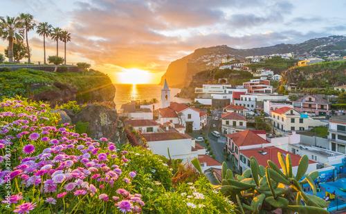 Wall mural Camara de Lobos village at sunset, Cabo Girao in background, Madeira island, Portugal