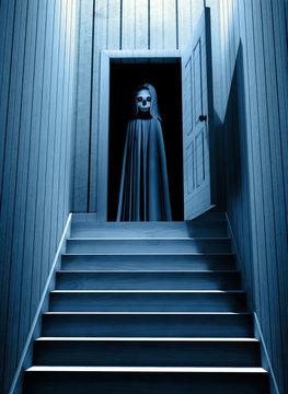 Spooky death with glowing eyes in opened door
