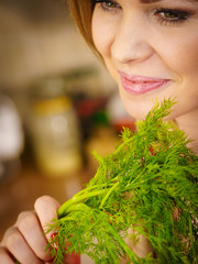 Young woman holding dill herb