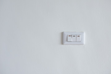 white lighting switchs on concrete wall