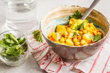 Vegan chickpea vegetables with coconut milk and cilantro.