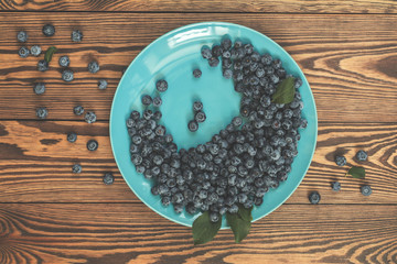 Many juicy beautiful amazing nice blueberries in blue dish