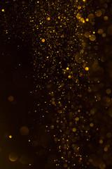 Glitter golden sparkling dust falling shiny abstract bokeh background