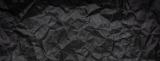 Ragged crumpled dark black paper texture background Wall mural