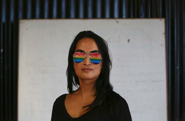 A reveller in rainbow glasses poses for a picture before taking part in the LGBT pride parade to mark Gaijatra Festival, also known as the festival of cows, in Kathmandu
