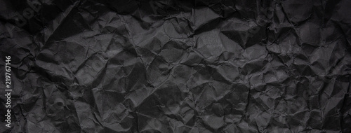 Fototapete Ragged crumpled dark black paper texture background