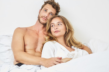 Morning couple lying in bed