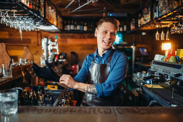 Bartender puts on rubber gloves at the bar counter
