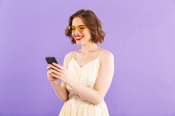 Excited young woman using mobile phone