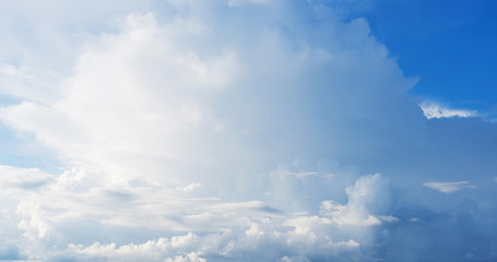 Blue sky background with clouds. Close up.
