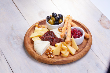Poster Entree cheese plate with olives
