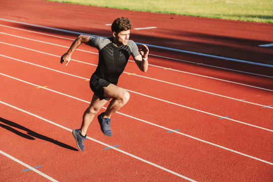 Strong young sportsman running