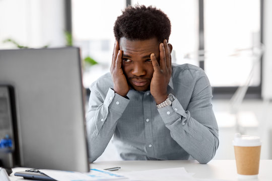 business, people, deadline and technology concept - stressed african american businessman with computer working at office